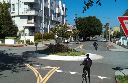 Mini-roundabouts are one possible treatment for bicycle-friendly streets. (Credit: LADOT Bike Blog)