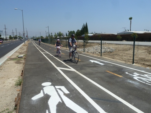 Walk and bike lanes with father and daughter riding their bikes