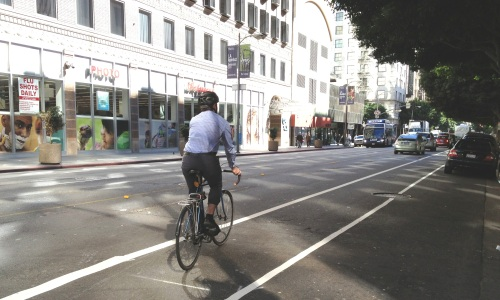 LADOT Bikeways Coordinator Nate Baird rides the newly striped eastbound bike lane on 7th (Credit: LADOT Bike Blog).