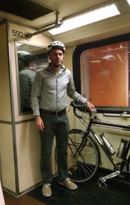 Holding my bike while riding the Red Line Subway into Hollywood.